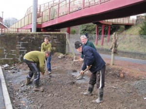 Bed by the Station — Volunteers hard at work in not really a bed but just stones…