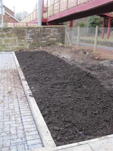 Bed by the Station — a dramatic change: level and full of soil